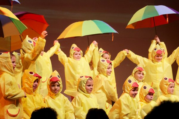 Students dancing in raincoats