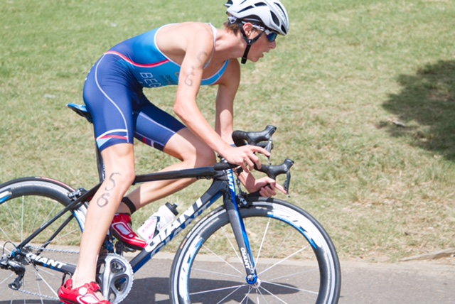 Student cycling in a triathlon event