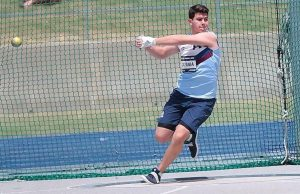Student competing in hammer throw