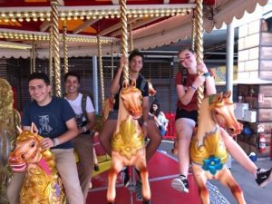 Students on carousel